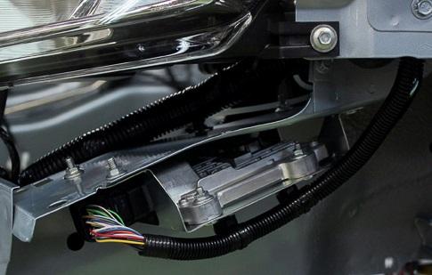 Контроллер АКПП Лады Гранты расположен у левой передней фары